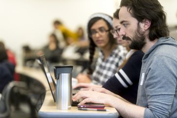 Students and data analysts gather for UBC's third annual Learning Analytics Hackathon on Saturday, March 10, 2018. Participants worked on open data sets and proposed design visualizations for course-based initiatives in order to identify patterns in student engagement to improve learning. (Photo by Abigail Saxton)